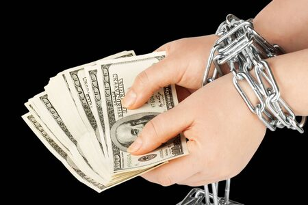 Hands with dollars in chain on a black background Stock Photo - 12460758