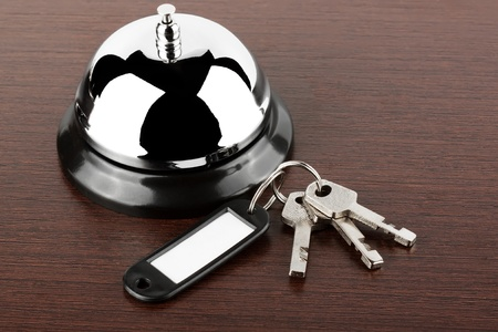 high key: Service bell with keys on the wood background
