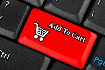 icon shopping cart: Red Einzelhandel Einkaufswagen-Symbol-Taste auf einer Tastatur Lizenzfreie Bilder