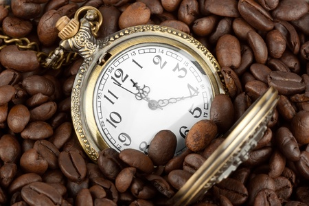 Extreme closeup Pocket watch in coffee beans photo