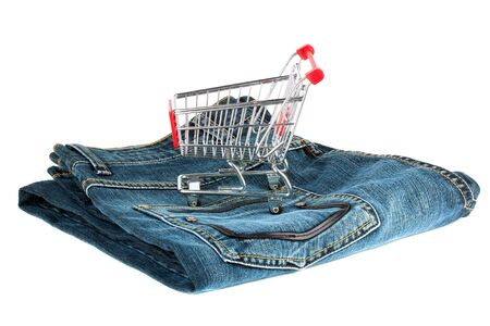 Shopping Cart with Jeans on the white background photo