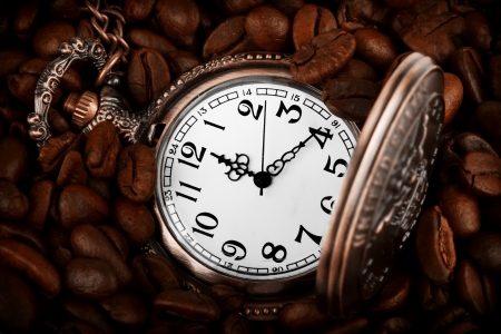meal time: Extreme closeup Pocket watch in coffee beans Stock Photo