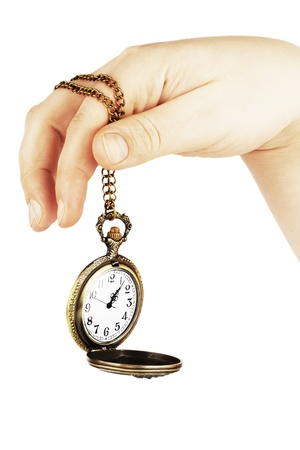 Golden pocket watch in hand on the white background Stock Photo - 12460909