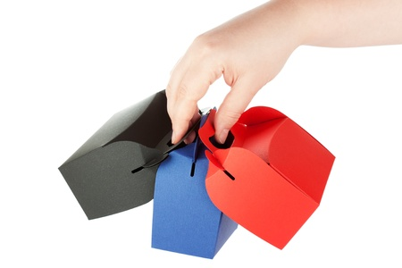 Gift Shopping red, black and blue Boxes in hands on the white background photo