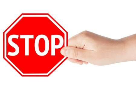 A hand holding a traffic sign stop on the white background Stock Photo - 12787233