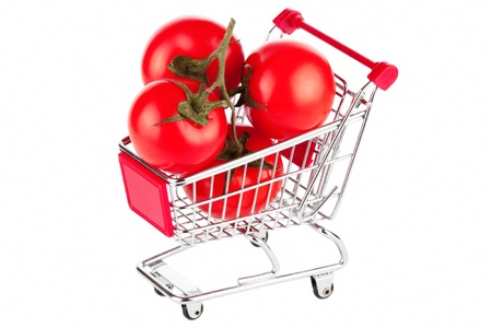Perfect tomatoes in shopping cart on the white background Stock Photo - 12787546