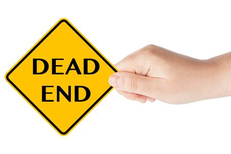 Dead end traffic sign with hand on the white background photo