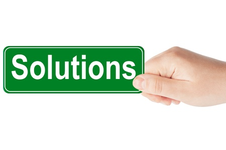 Solutions traffic sign in the hand on the white background
