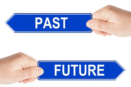 Past and Future traffic signs with hand on the white background photo
