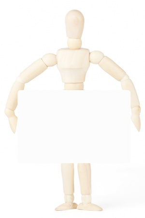 Wooden dummy showing blank paper on a white background, copy space for your text photo