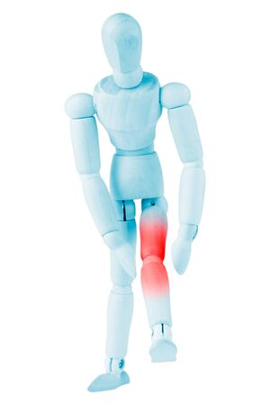Acute pain in a knee  Concept photo with blue dummy with red indicating pain on a white background photo