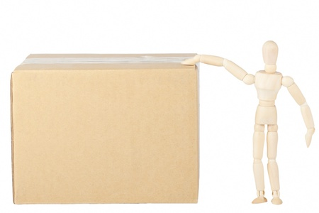 Wooden mannequin with the box on the white background photo