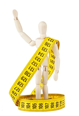 Weight loss Success Concept  Dummy with measuring tape on the white background photo