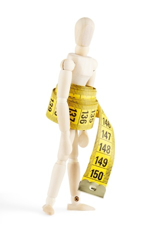 weight reduction plan: Weight loss Success Concept  Dummy with measuring tape on the white background Stock Photo