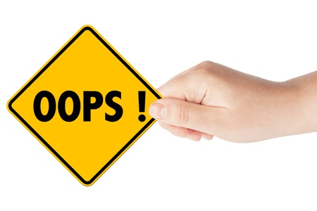Oops sign showing business concept with hand on the white background photo
