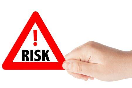 risks ahead: Triangulares signos de riesgo de tr�fico de color rojo con la mano sobre un fondo blanco
