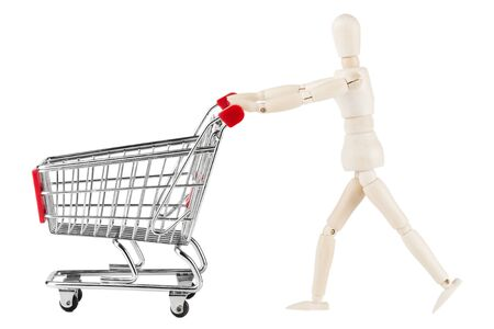 mart: Shopping concept. Wooden dummy and metal shopping cart on a white background