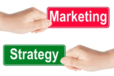 Strategy and Marketing traffic sign in the hand on the white background Stock Photo