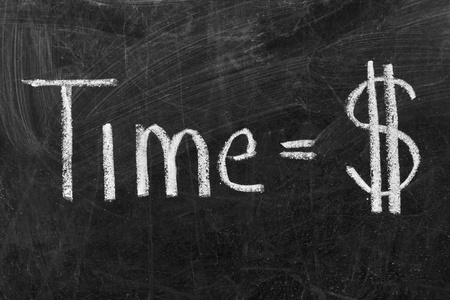 sign equals: Time is money sign handwritten with white chalk on a blackboard