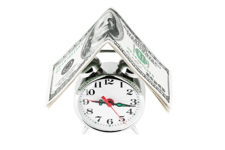managing money: Time is money concept. Retro styled alarm clock with the money.