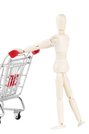 layman: Shopping concept. Wooden dummy and metal shopping cart on a white background