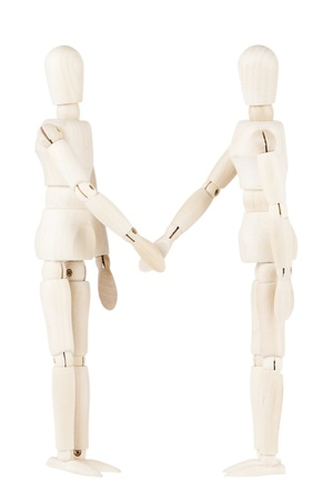 Wooden dummies shaking hands isolated on a white background photo