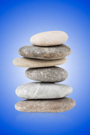 Pebbles balanced stack against on a blue gradient backround Stock Photo - 13424811