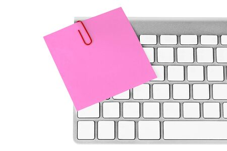 Red memo and paper clip on computer keyboard on the white background Stock Photo - 13473815