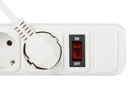 Power outlet with red button on a white background photo