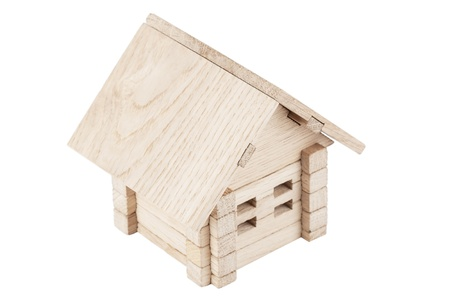 Toy wooden house on a white background photo