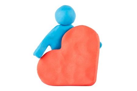 Plasticine man with plasticine heart on the white background Stock Photo - 13474163