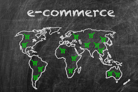E-commerce business written on a blackboard with world map sign photo