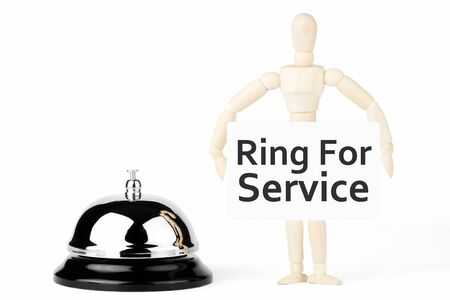 Service Bell, wooden dummy with ring for service sign on the white background photo