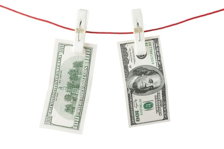 One hundred bills with clothespins on a white background. Stock Photo - 13599305