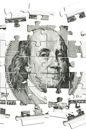 franklin: Puzzle Franklin  on 100 dollars bill on a white background