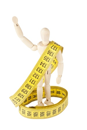 Weight loss Success Concept. Dummy with measuring tape on the white background Stock Photo - 13599332