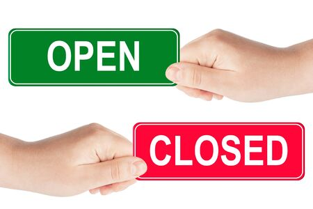 Open and closed traffic sign in the hand on the white background Stock Photo - 13681257