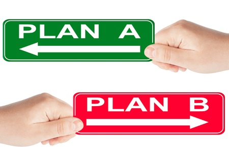 Plan A and B traffic sign in the hand on the white background photo