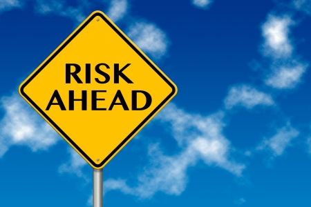 Risk ahead sign showing business concept on a sky background photo