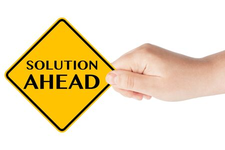 Solution ahead traffic sign with hand on the white background photo