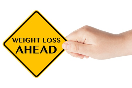 Weight Loss ahead traffic sign with hand on the white background photo
