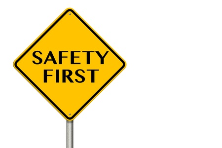 Safety First sign showing business concept on a white background photo