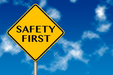 cautionary: Safety First sign showing business concept on a sky background