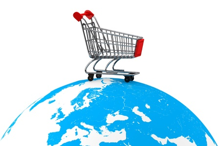 shopping buggy: Global market concept. Shopping cart over the Earth on a white background
