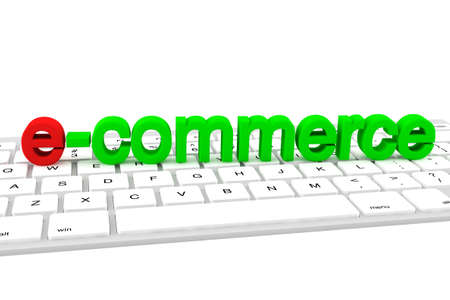 E-commerce concept. E-commerce green letters on a white keyboard photo