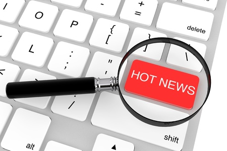 breaking news: Magnifying glass with keyboard  Hot News key on a white background Stock Photo