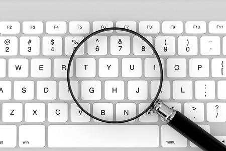 Magnifying glass with keyboard on a white background photo
