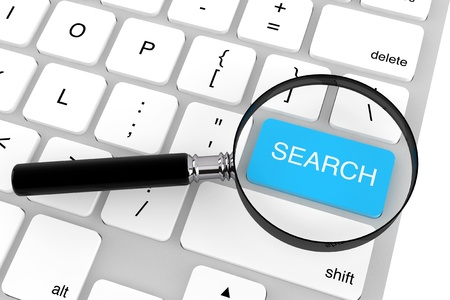 Magnifying glass with keyboard  Search key on a white background Stock Photo