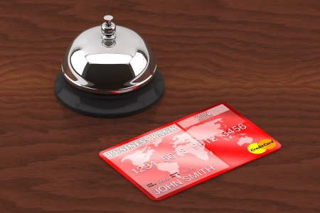 Service bell with Credit Card on a wooden desk photo