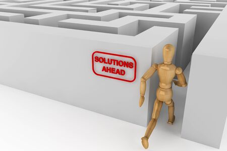 Wooden dummy runing to solution in labyrinth photo